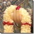 [flower garland offered to Krishna]