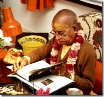 [Prabhupada with his books]