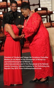 Dr Kris Rampersad receives National Medal for Development of Women Gold from President Paula Mae Weeks