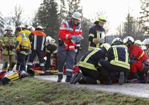 Emergency personnel treat injured persons at the site of a train accident near Bad Aibling,Germany, Tuesday, Feb. 9, 2016. Several people were killed in the crash. (Uwe Lein/dpa via AP)