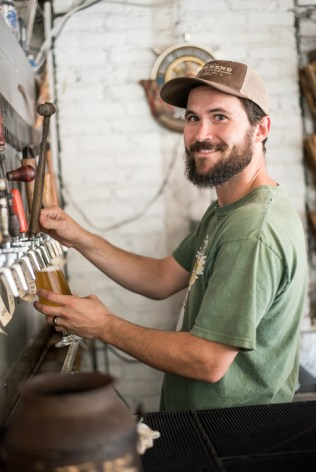 All smiles at Burial Brewing in Asheville's South Slope neighborhood.