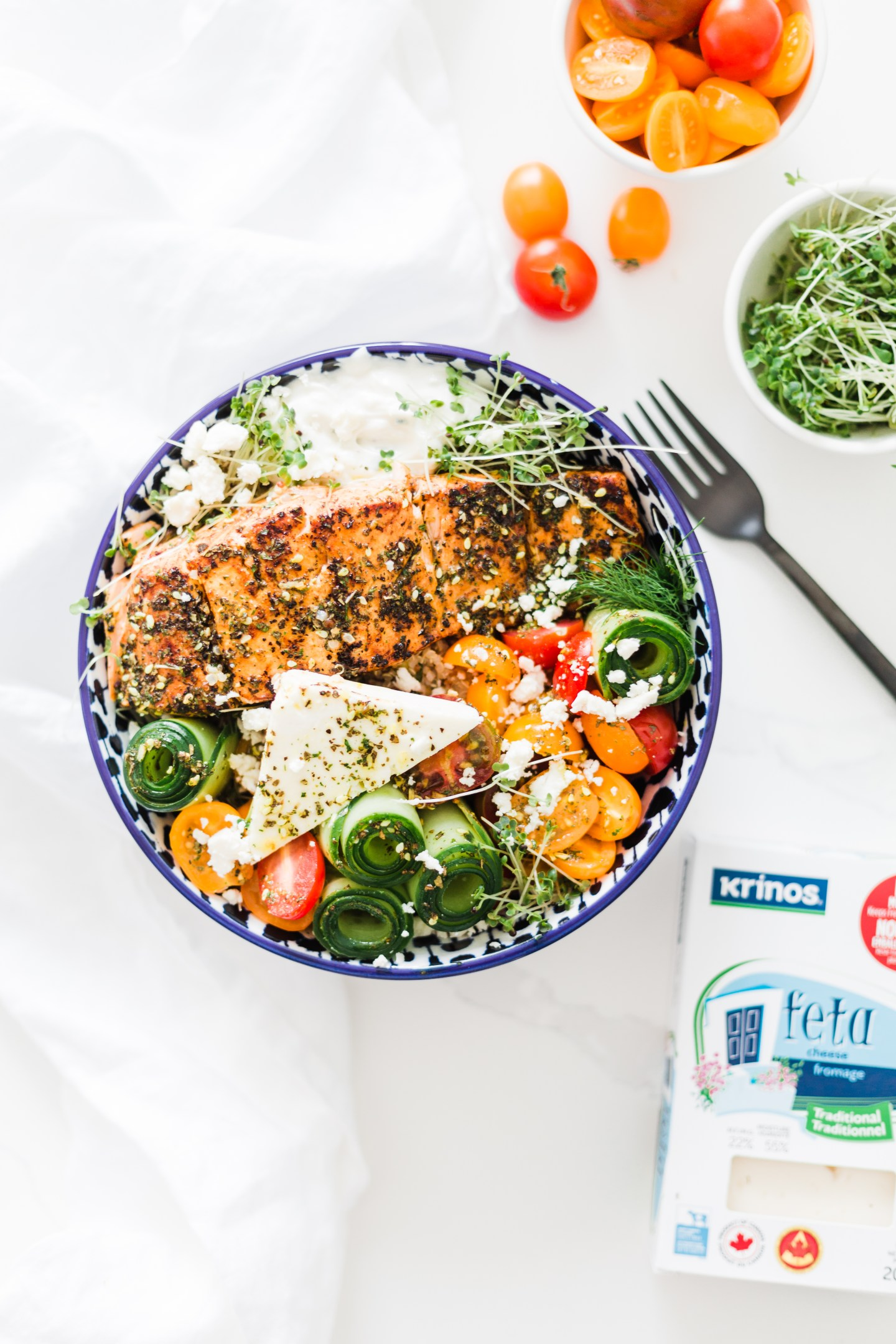 Mediterranean Salmon bowls | greek marinated Salmon, loaded with quinoa, cute cucumber rolls,⁣ tomatoes, fresh herbs, tzatziki and feta #under30minutemeals #salmonbowl #dinnerideas #whatsfordinner #salmon