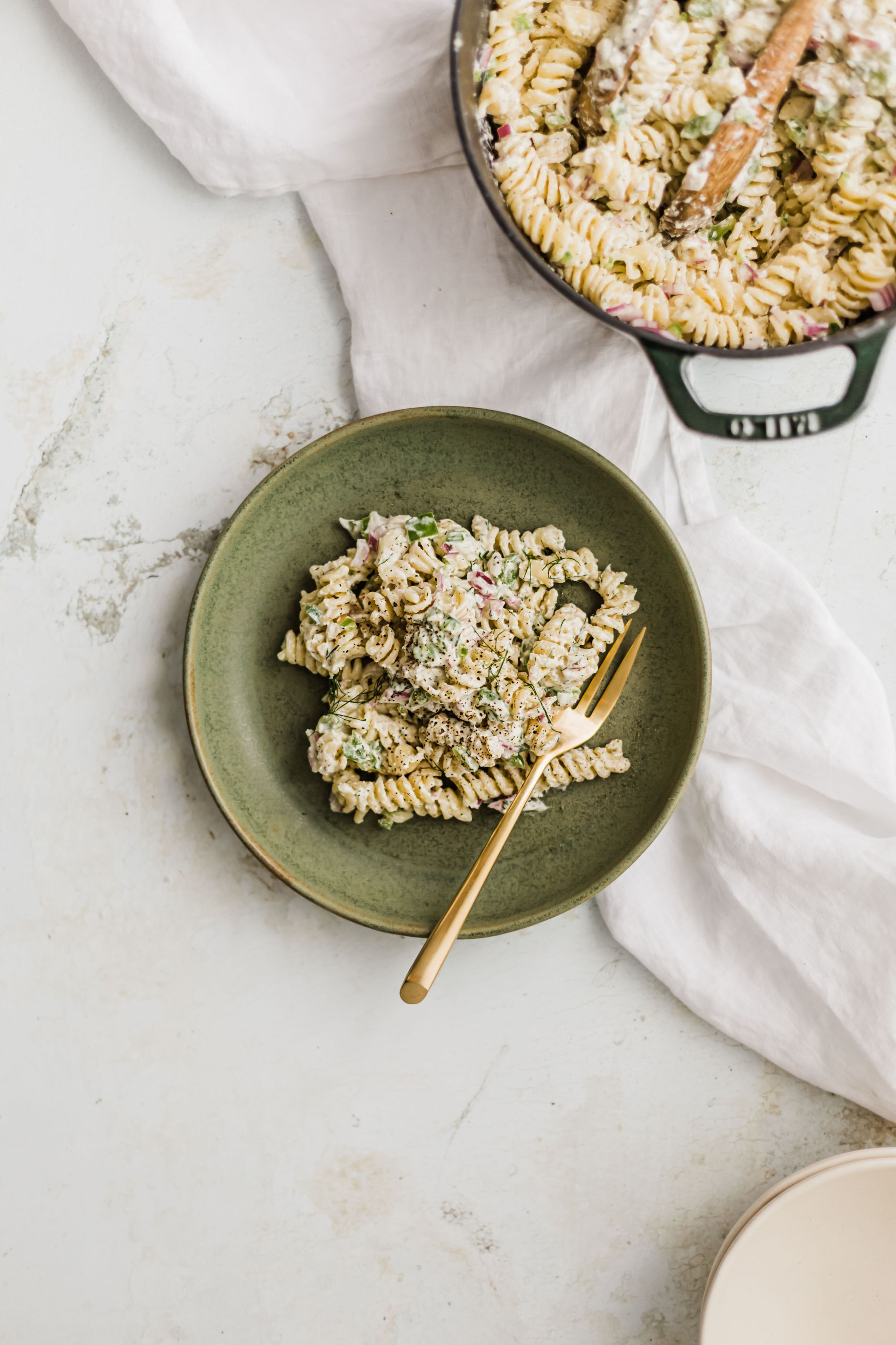 Creamy Feta & Dill Pasta Salad features a creamy feta & fresh dill dressing and peppers and red onions for the perfect crunch!