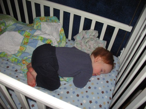 Baby sleeping in White crib