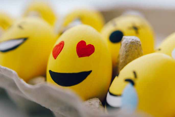 yellow smiley emoji painted eggs