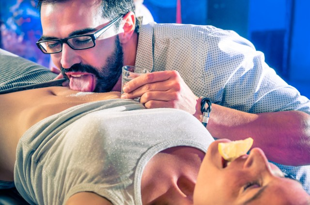 Couple having fun in disco night club with body tequila party