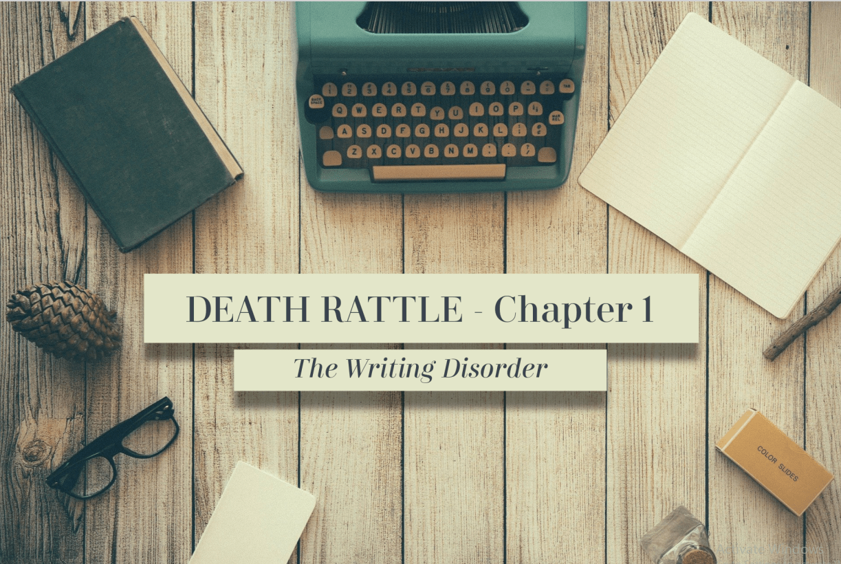 """An image of a wooden tabletop from above. In the center, the image reads: """"Death Rattle: Chapter 1. The Writing Disorder."""" Around the text lay a blue typewriter, an open empty notebook, a box of film slides, a pair of glasses, an old book, and a pinecone."""