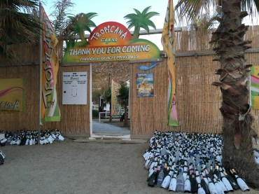 Tropicana beach and it's collection of champagne bottles.