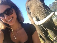Travel and wildlife presenter with elephant