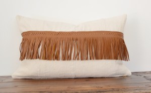 vintage white mudcloth and brown leather fringe lumbar