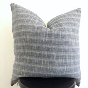gray and blue vintage pillow