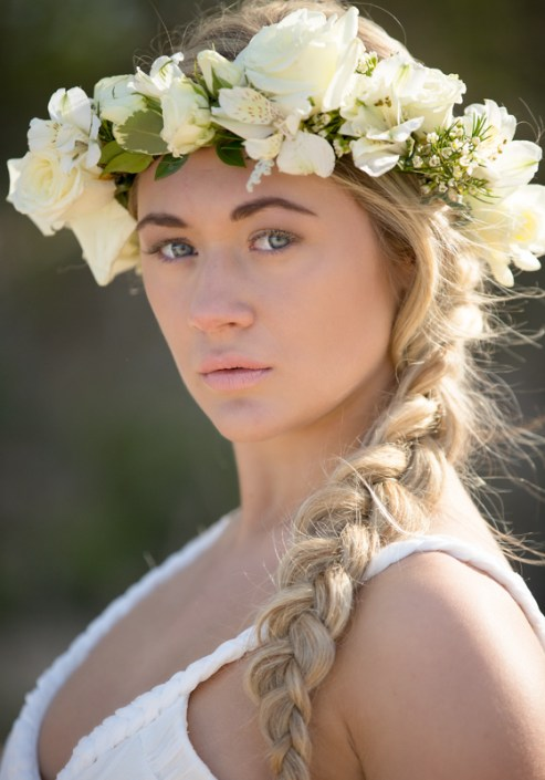 Young woman with a floral wreath on her head