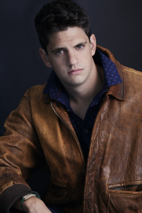 Portrait of a young man in a leather coat
