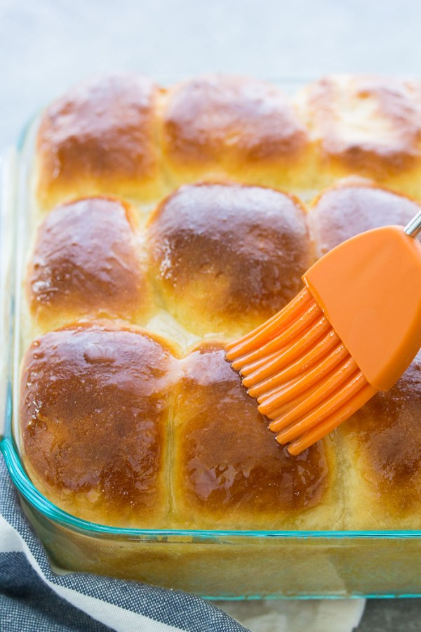 Honey yeast rolls brushed with honey butter.