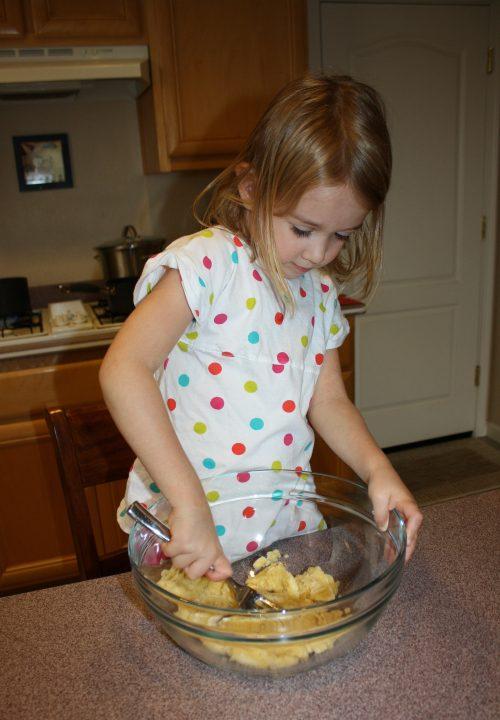 Kids in the kitchen, mashing bananas for banana bread