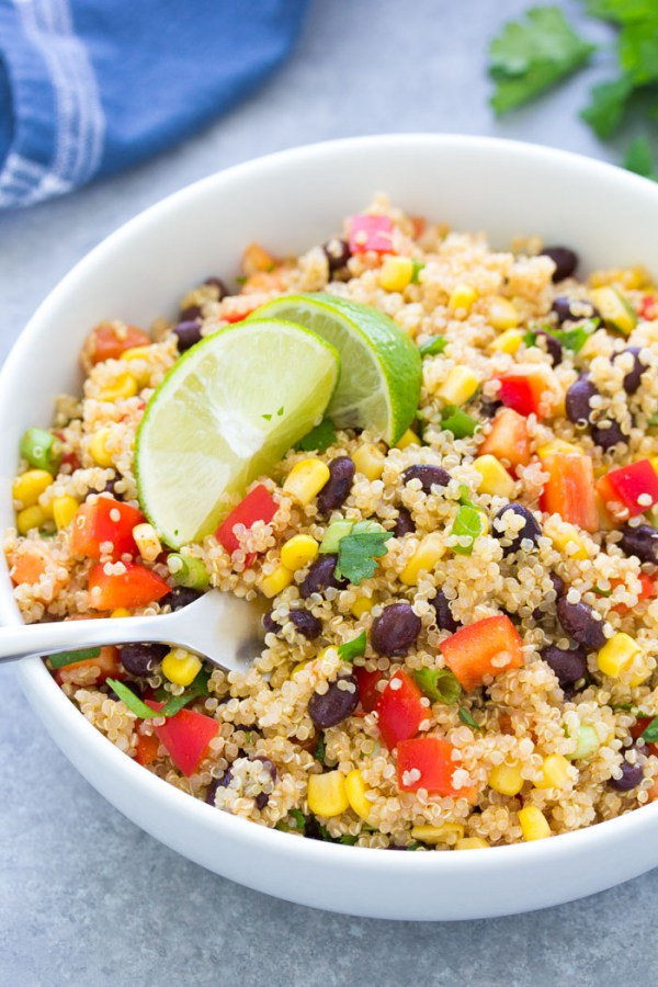 Southwest quinoa salad with lime vinaigrette and black beans in a bowl.