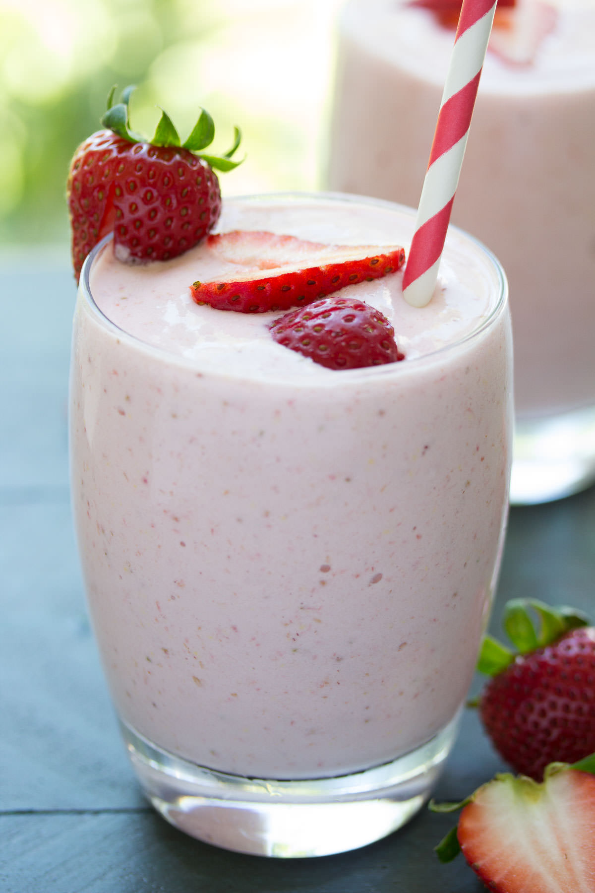 This Strawberry Milkshake Smoothie tastes just like a strawberry milkshake, but it's healthy! Protein-packed Greek yogurt makes it super creamy!