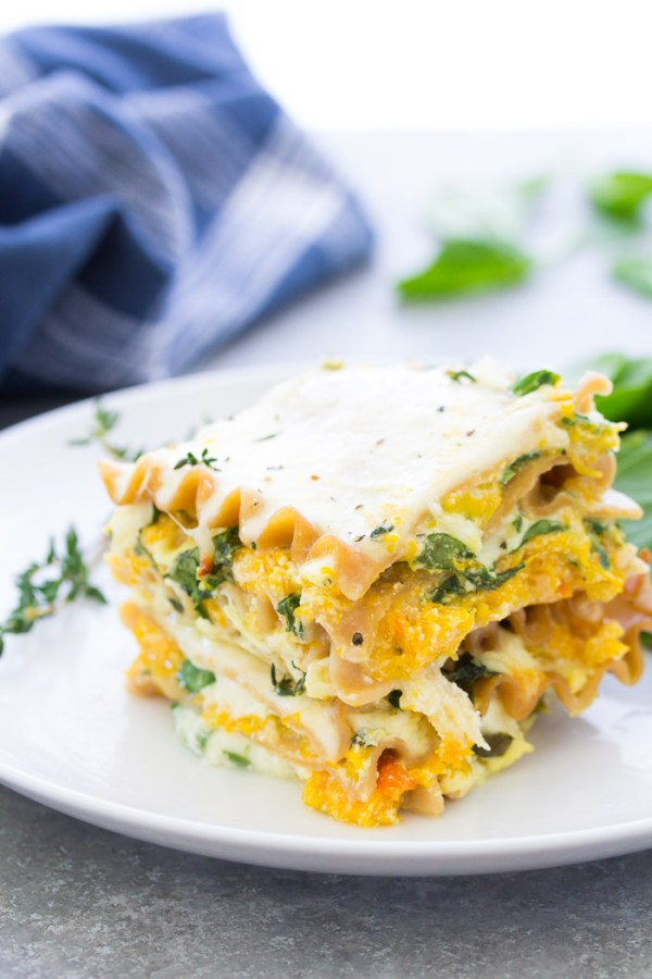 Creamy roasted butternut squash lasagna with spinach.