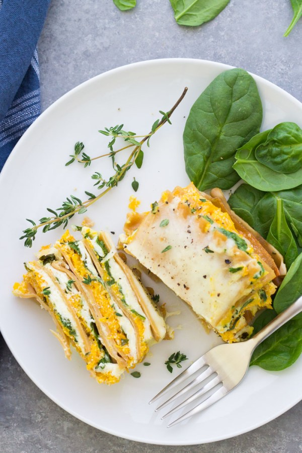 Creamy roasted butternut squash lasagna with spinach. This vegetarian lasagna recipe is one of our favorites, made with ricotta, mozzarella and Parmesan cheeses!