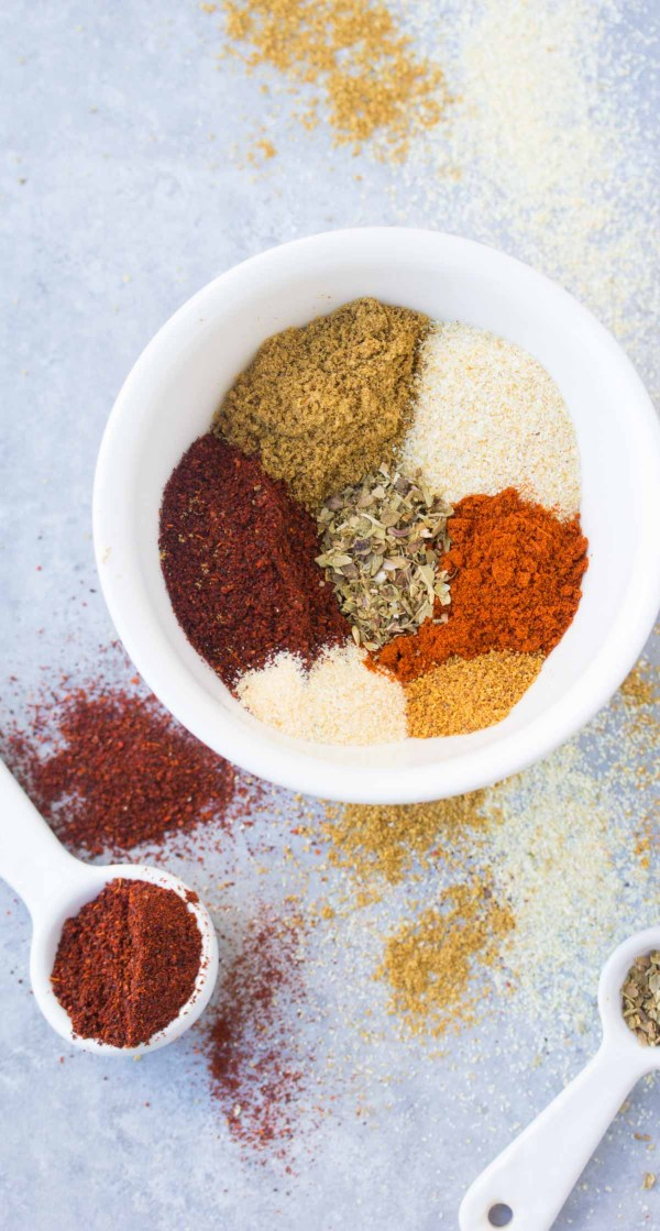 Spices in a bowl to make diy taco seasoning.