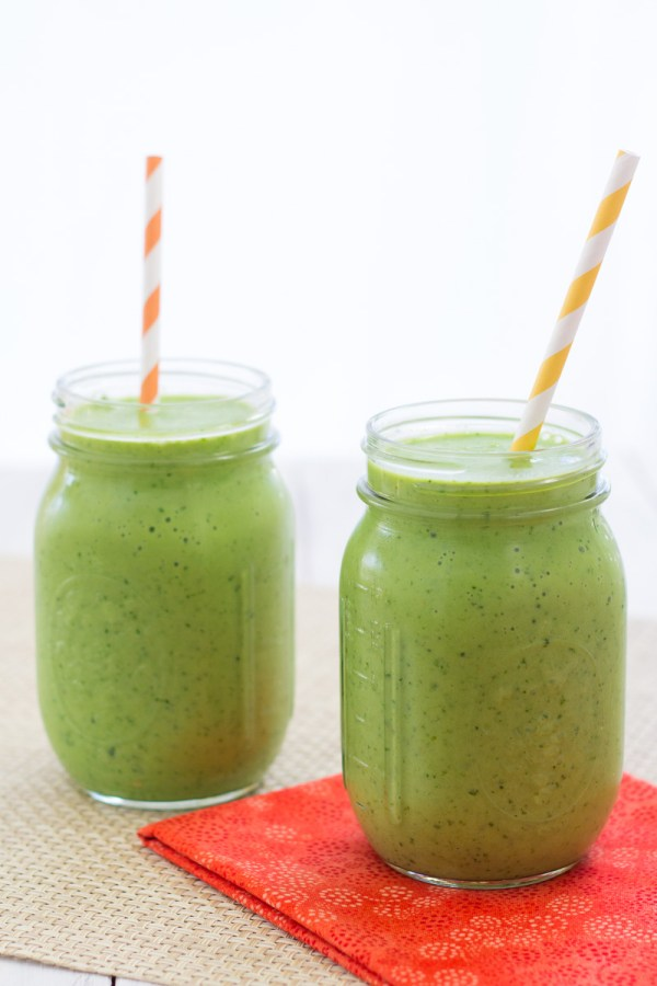 Side view of two kale smoothies.