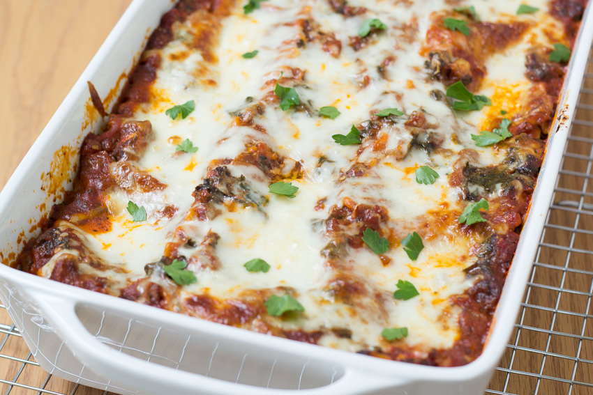 baking dish with kale and mushroom lasagna just baked in the oven