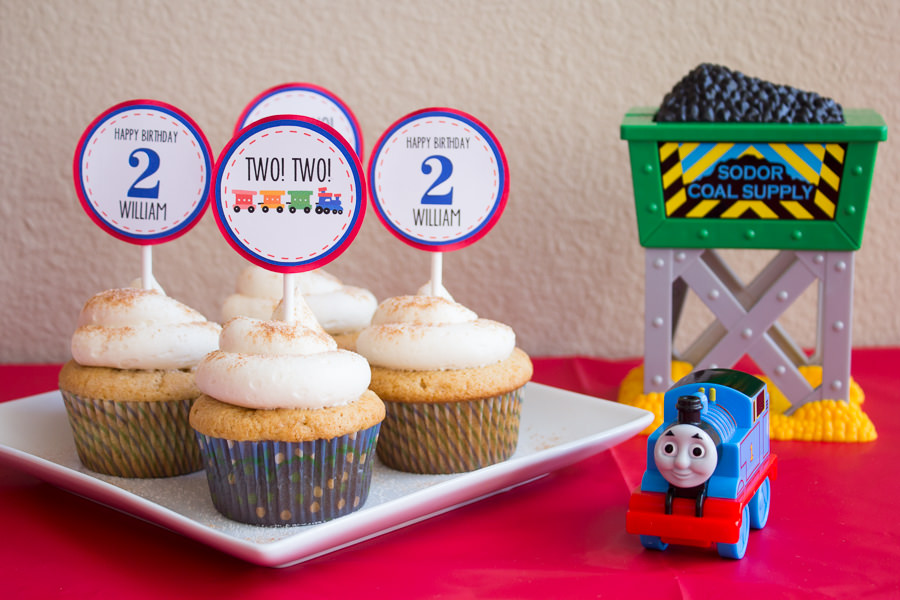 cupcakes on a plate for 2 year old birthday with thomas the train