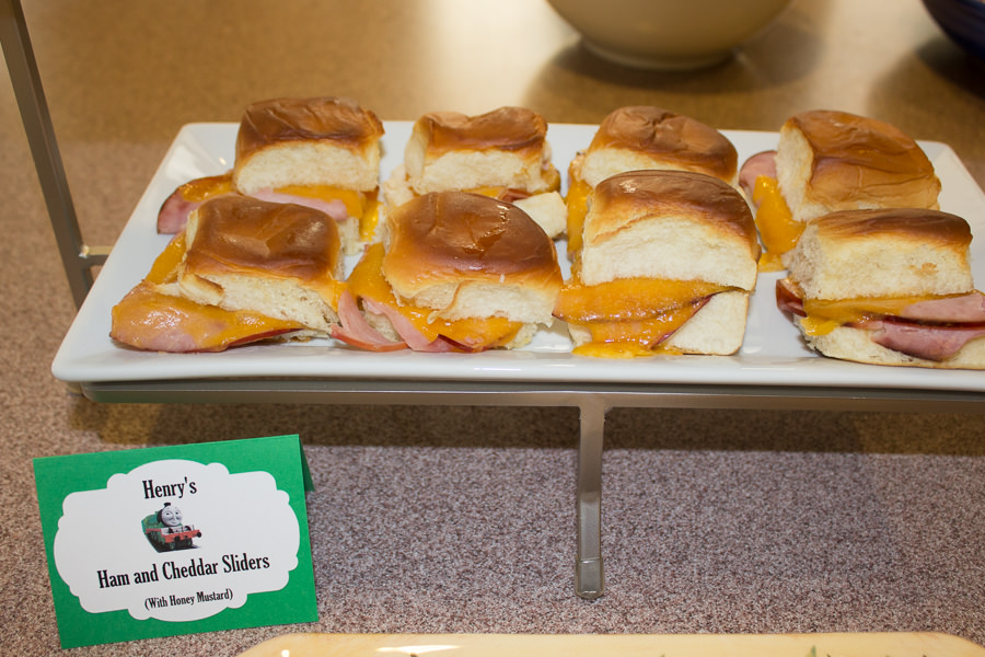 ham and cheese sliders on an elevated serving tray