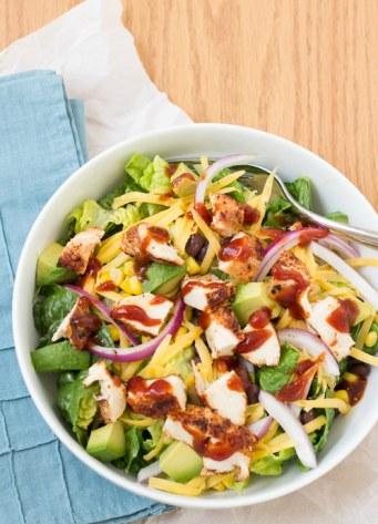 bbq chicken salad in a white bowl