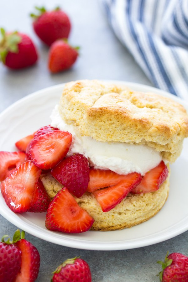 Classic strawberry shortcake made with a biscuit on a plate.
