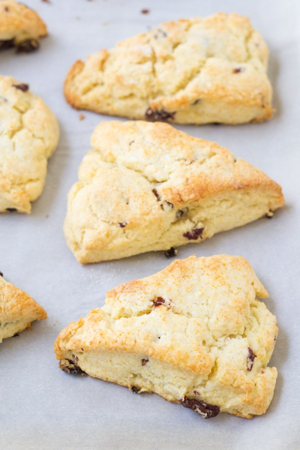 Cherry cream scones on a baking sheet.