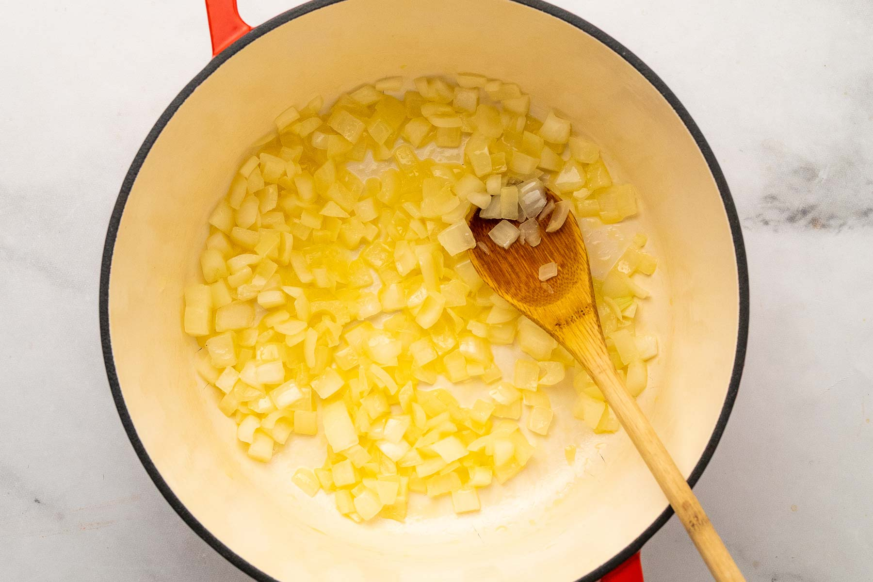 sauteing onion in butter for carrot soup