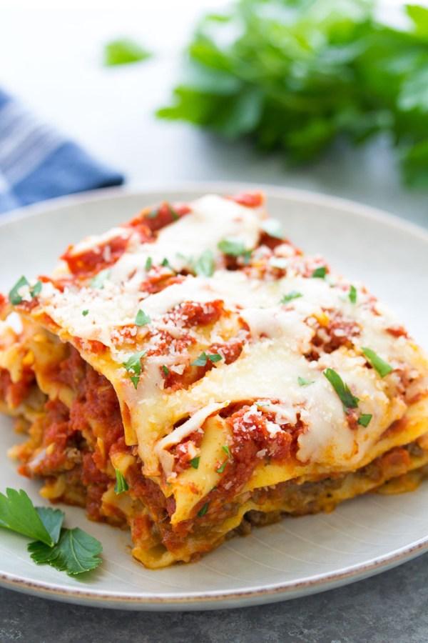 A slice of crockpot lasagna on a plate.