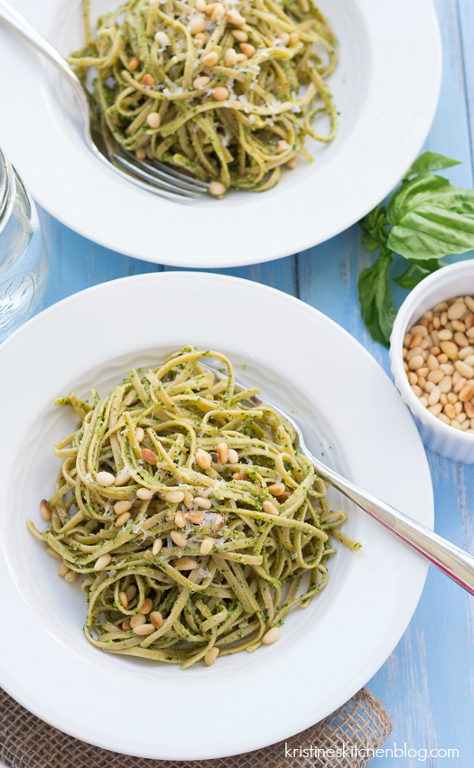 kale pesto pasta on a white plate with fork