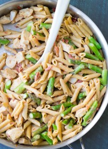 One Pot Creamy Asparagus Chicken Pasta. This easy one pan dinner is full of vegetables, whole grain pasta and lean protein! | www.kristineskitchenblog.com