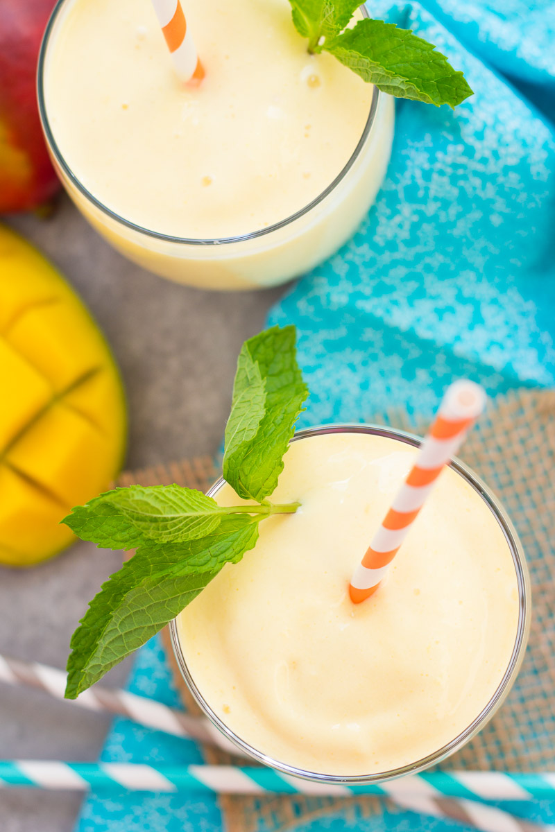 Top down view of two mango smoothies.