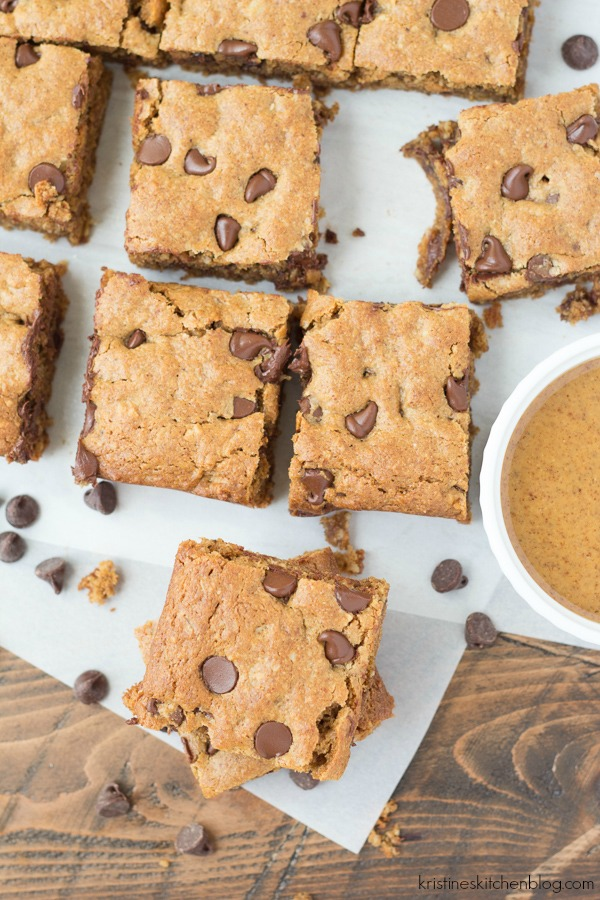 chocolate chip blondie bars cut into squares on parchment