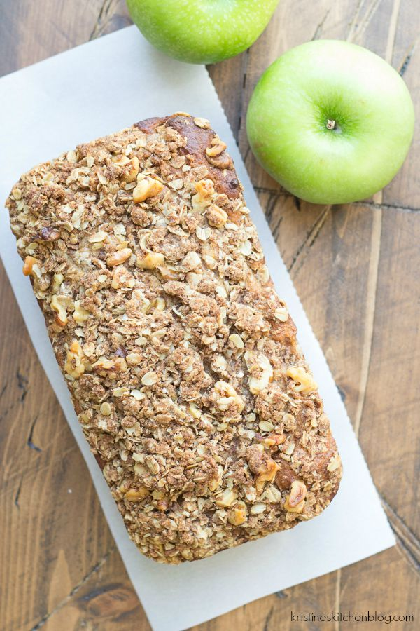 styled photo of a loaf of apple cinnamon quick bread with nut streusel topping