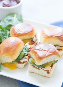 BBQ Chicken Sliders with Cheddar and Spinach. BBQ sauce, gooey cheddar and chicken make for one tasty little sandwich!