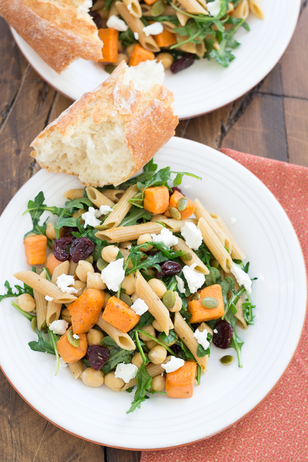 Roasted Sweet Potato and Arugula Pasta with Chickpeas. This 30 minute meal is packed with flavor and perfect for busy weeknights!