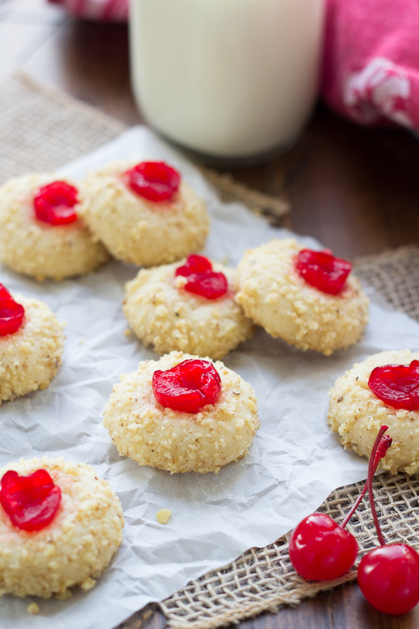 Cherry Cream Cheese Cookies. My family bakes these every year at Christmas! These holiday cookies are rolled in nuts and topped with a maraschino cherry. They are melt-in-your-mouth good!