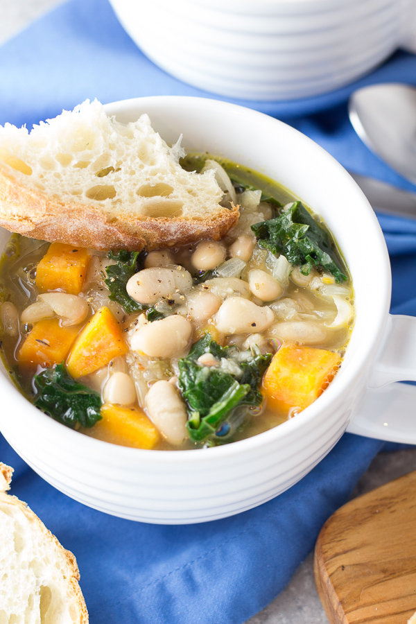 closeup photo of tuscan white bean soup with kale and butternut squash