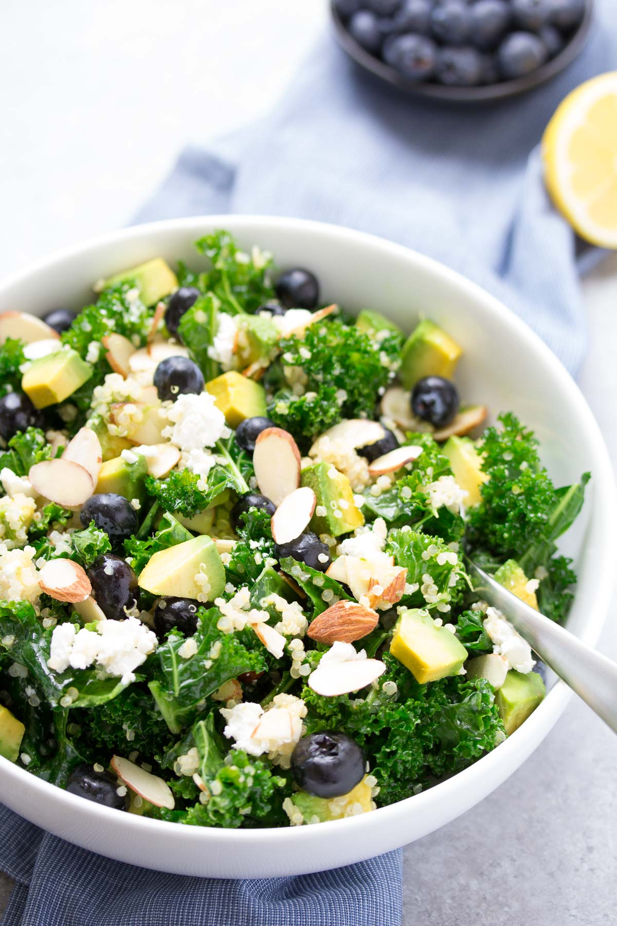 Kale Salad with avocado, quinoa, goat cheese, blueberries and almonds.