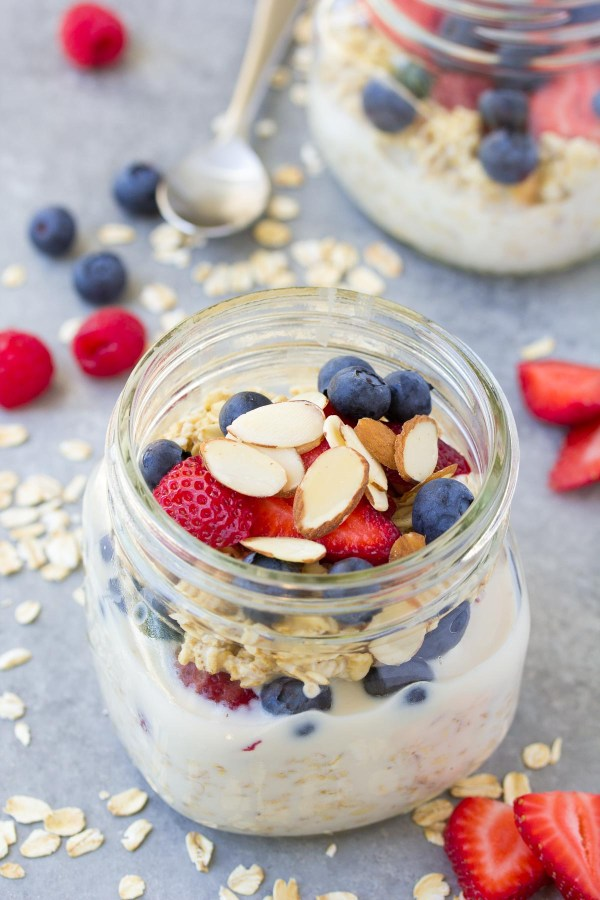 Basic overnight oats recipe: oats in a jar topped with fresh berries and almonds.