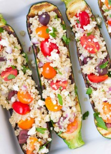 close up of stuffed Zucchini Boats in white serving dish