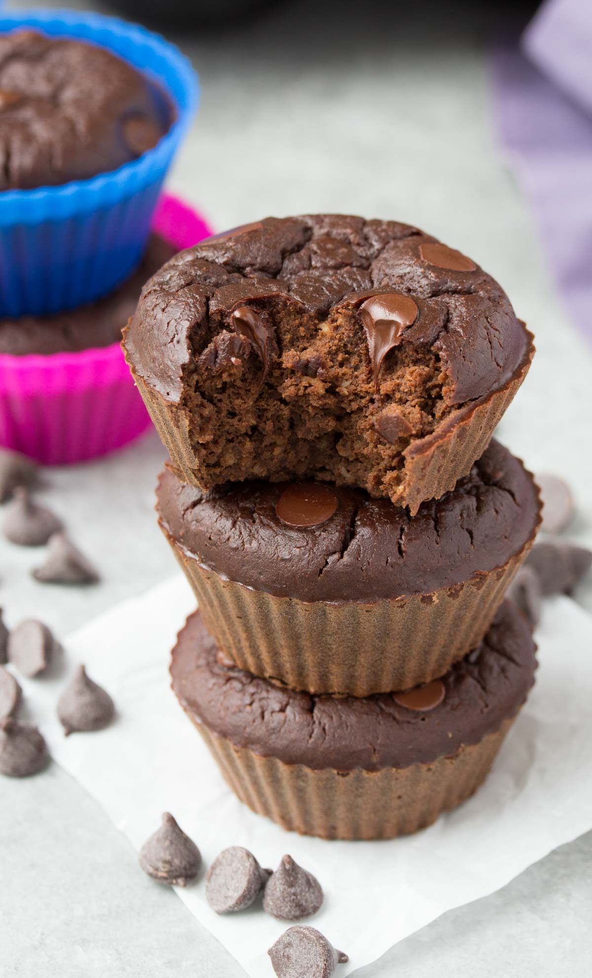 Chocolate Black Bean Blender Muffins, three muffins stacked on top of each other.