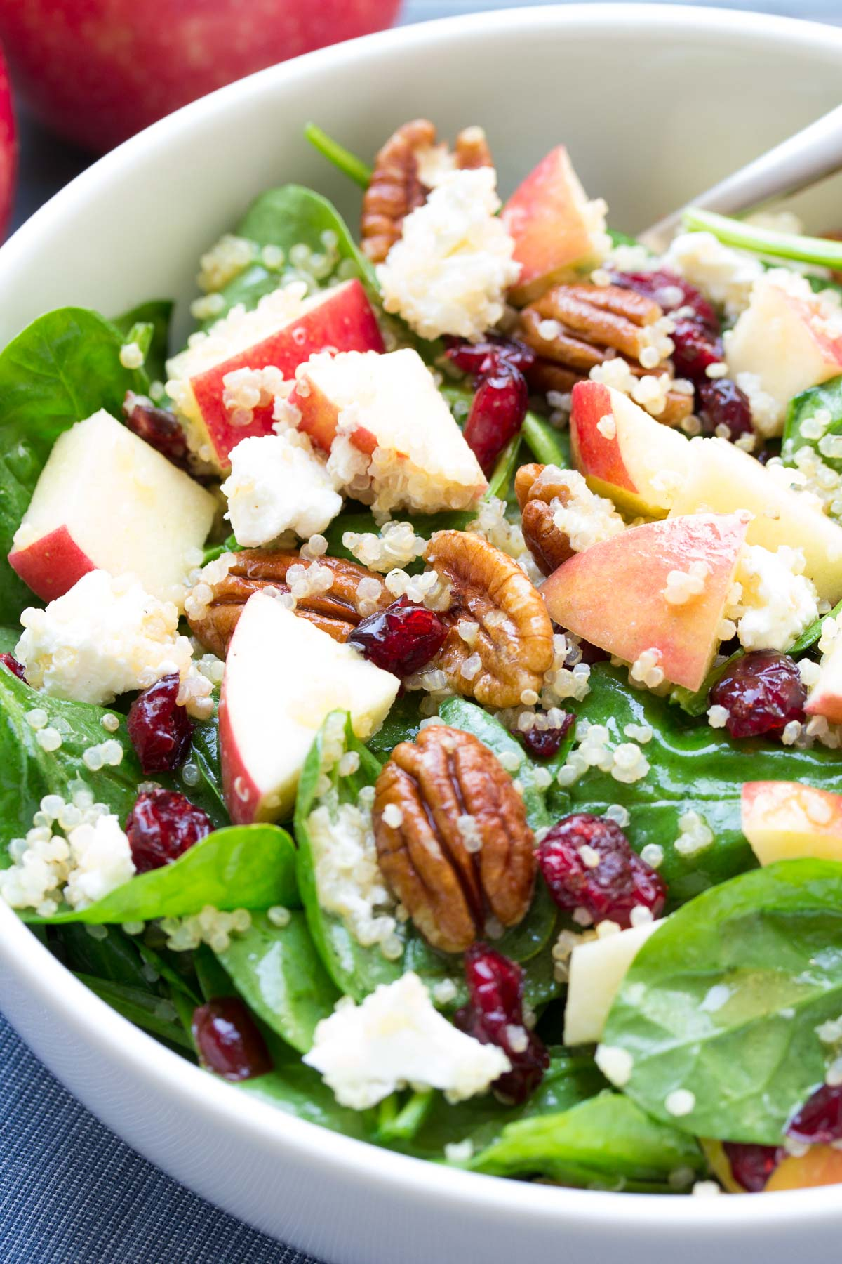 Spinach and Quinoa Salad with Apple and Pecans. SO FULL OF FLAVOR! My favorite healthy lunch and dinner side dish!   www.kristineskitchenblog.com