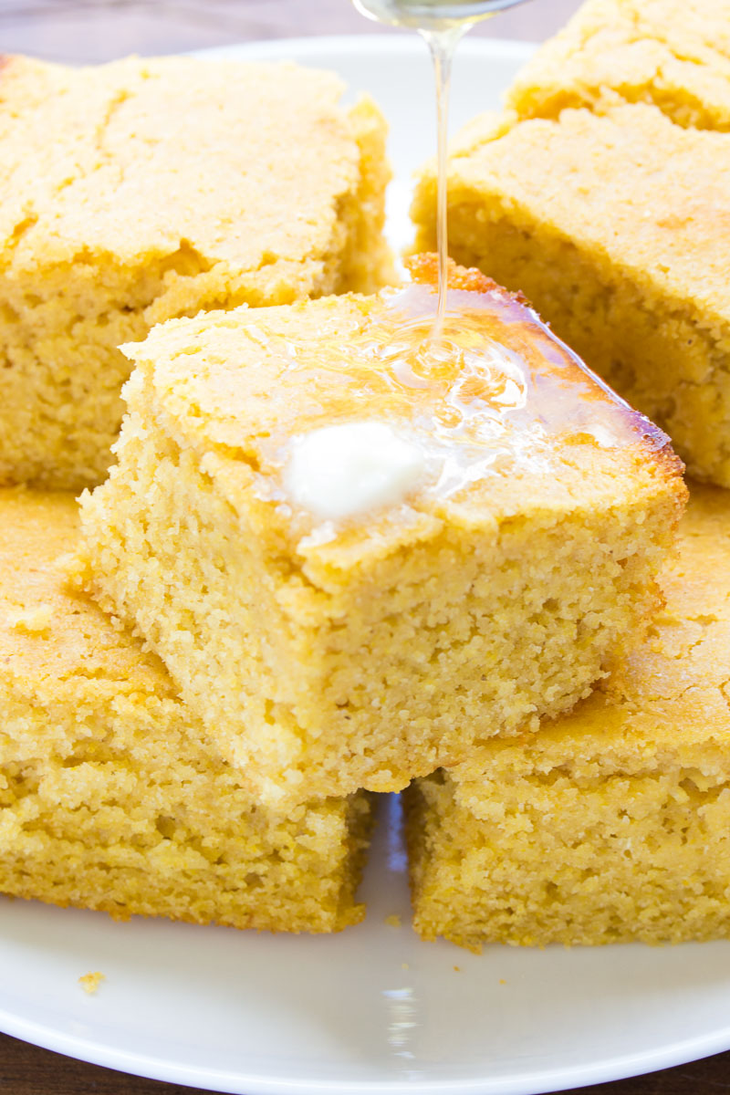 cornbread stacked with butter and honey