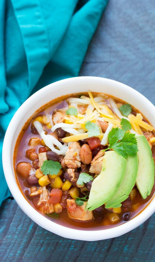Dump and go (no chopping) easy slow cooker chicken taco soup recipe. A family favorite, made in your crock pot!   www.kristineskitchenblog.com