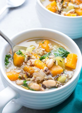 Slow Cooker Wild Rice Vegetable Soup - This healthy crock pot soup is great for meal prep lunches and dinners! With butternut squash and kale. Vegetarian & Vegan | www.kristineskitchenblog.com